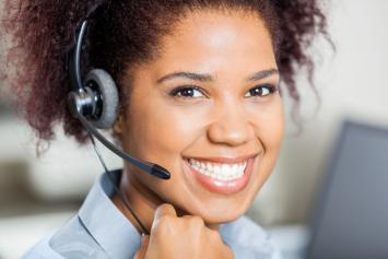 Smiling young woman in headset
